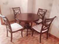 pine extendable dining room table with four chairs