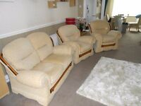 Three piece suite with reclining chair.