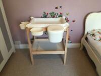 Singlar changing table and accessories.