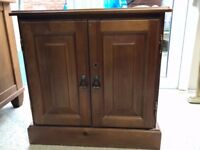 Wooden cupboard with hole in back to link DVD/TV