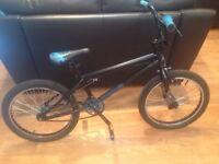 Mongoose BMX bike and helmet