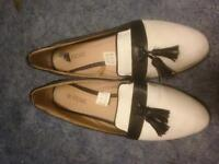 Ladies white and black tassel flat shoes offers