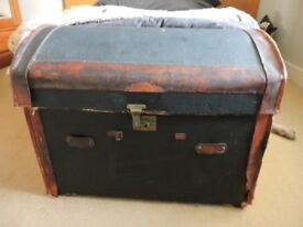 Antique Black and tan leather travel trunk/ottoman with brass catches