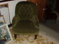 retro armchair in green velvet with wooden legs