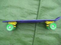 Ozbozz Purple Plastic 22 Inch Skateboard for £5.00