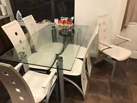 Glass Topped Dinning Table /6 white leather chairs