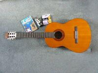 Yamaha acoustic guitar with accessories