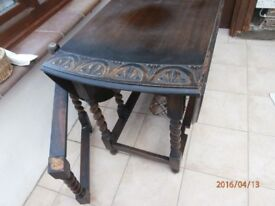 solid carved oak gate-leg table