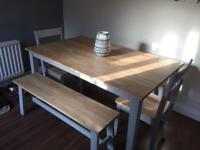 Farmhouse style dining table with benches and chairs