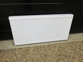 As new 1200 x 600 Double radiator c/w taps & fittings.