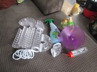 Hamster tubes, spinning wheel, water bottle, food, cleaning spray and sawdust