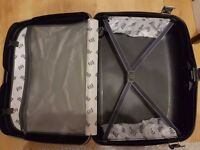 Samsonite hard-shell suitcase with wheels