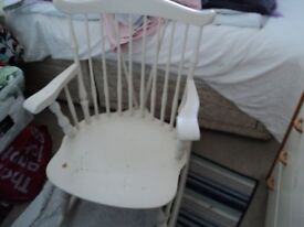 an old solid rocking chair at present painted in white.
