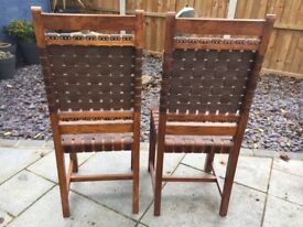 Beautiful wood and leather bound pair of chairs
