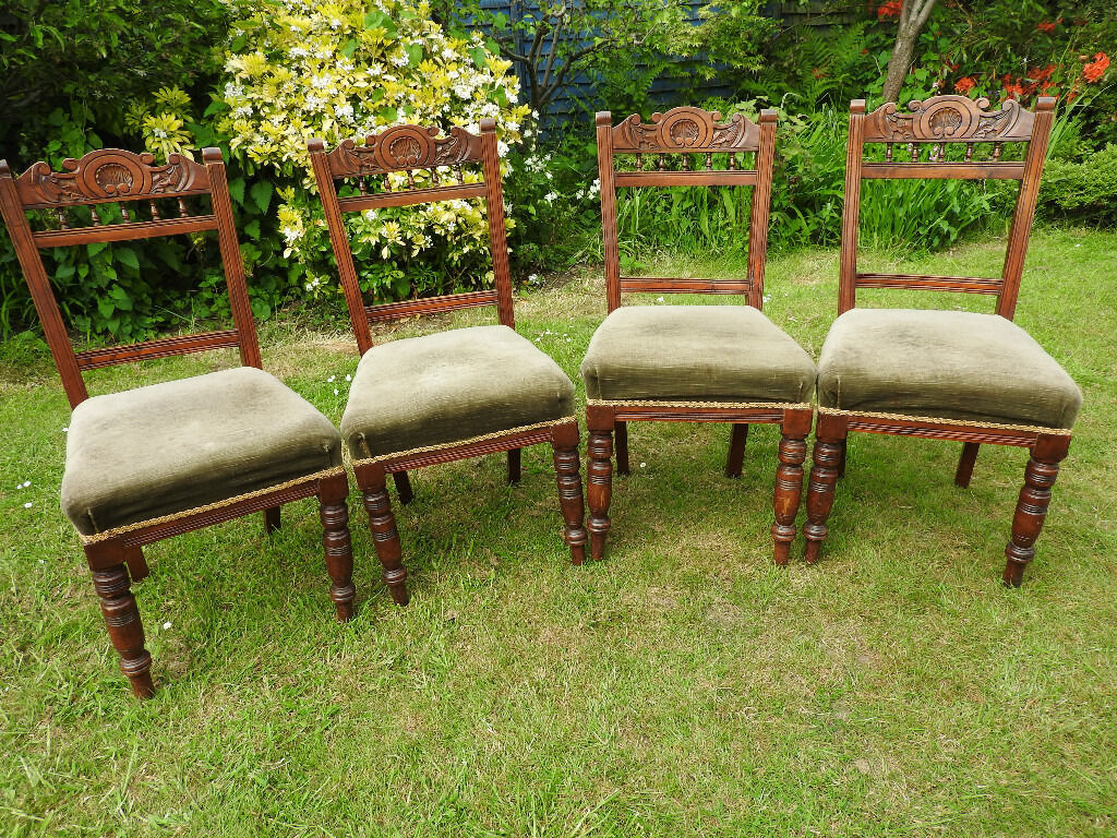 four ornate backed dinning chairs, green Velvet covered seats (4)