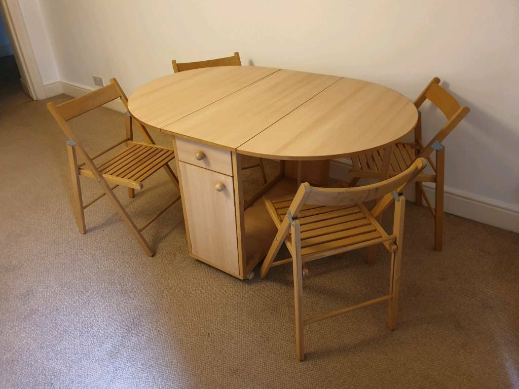 - Fantastic Space Saving Dining Table With 4 Folding Chairs And Storage