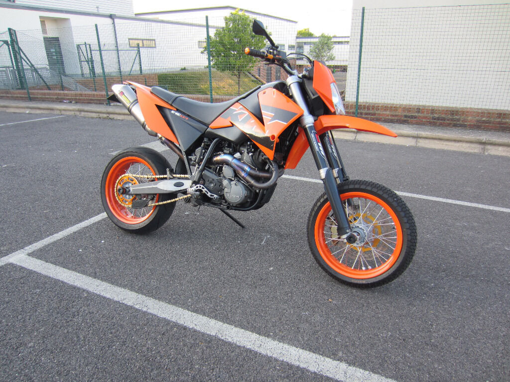 ktm lc4 640 supermoto 2005 in orange with full akrapovic