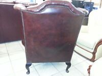 lovely high back queen Anne armchair. ox blood chesterfield
