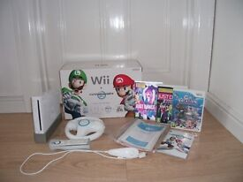 New Nintendo Wii = Mariokart Wii in box with instructions