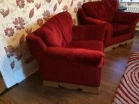 Two red single seat armchair