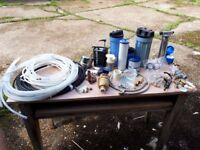 Various water pumps, filters and plumbing bits and pieces