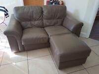 Stunning 2 leather 2 seater sofas and footstool
