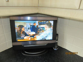"""16"""" DM Tech TV on stand with included DVD player."""