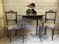 Vintage, circular dining table with french legs and 2 upholstered dining chairs in french Linen