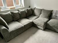 Grey corner sofa with footstool