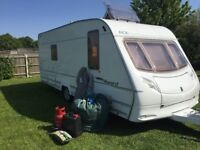 ACE AWARD 2005 ALL PAPERWORK, 4 BERTH FIXED BED WITH FULL SIZE AWNING AND CARAVAN COVER,
