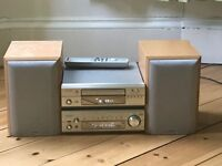 Denon sound system complete with speakers, remote and iPod dock