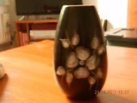 Black vase with embossed flowers