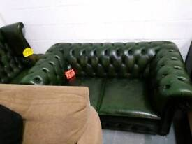 Green chesterfield sofa and wing chair
