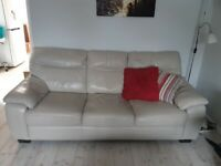Leather sofa with reclining arm chair