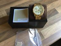 Michael Kors watches, one silver and one gold
