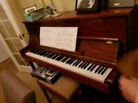 Reid sohn upright gloss walnut case piano