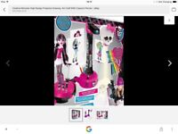 Monster high projector and 2 dolls