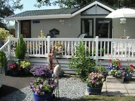 HOLIDAY LODGE ON SHOREFIELD MILFORD ON SEA 5 MINS WALK TO SEA SECLUDED POSITION WITH SMALL GARDEN