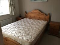 Pine double bed with headboard and mattress
