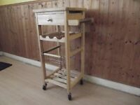 Kitchen storage Trolley in solid beech wood. Tile top, wine rack.
