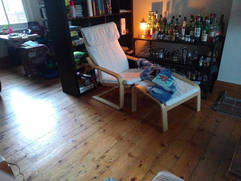 white IKEA POANG arm chair with footstool