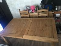 Extendable dining table with 6 matching chairs