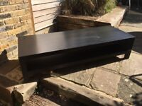 Nice wooden coffee table! (or games console or TV stand).