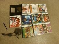 NINTENDO DS,lite BLACK CONSOLE WITH 10 BOXED GAMES.