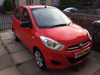Red Hyundai i10 1.2L Hatchback 5 Door. Super low mileage and clean. Perfect First Car!