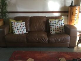 Two 3 seater leather sofas and one storage pouf.