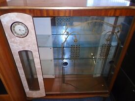 vintage glass and mirrored back display cabinet .