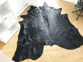 Black cow hide rug