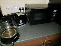 Black set: microwave, toaster and kettle