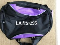 LA FITNESS Branded Backpack. Black with purple inserts. Brand New.